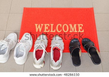 Pairs Of Shoes At The Door Step - stock photo