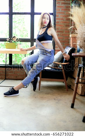 Pak Khat,Bueng Kan,Thailand-2017-06-05 :A Sexy woman wearing black Adidas shoes and Calvin Klein underwear in The Olw coffee shop.