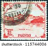 PAKISTAN - CIRCA 1955: A stamp printed in Pakistan issued for the 8th anniversary of Independence shows Karnaphuli Paper Mill, East Bengal, circa 1955. - stock photo