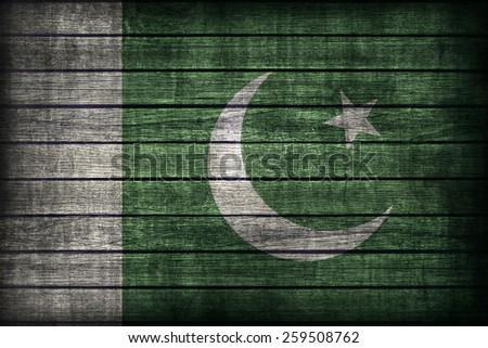 Pakistan flag pattern on wooden board texture ,retro vintage style - stock photo