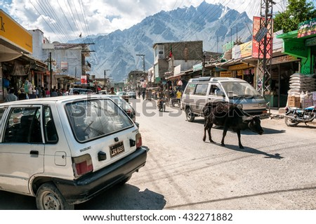 Pakistan, Skardu, June 2015 - Cow walking on street in Skardu, mountain town, from which every expedition to K2, Broad Peak, Gasherbrums and other high Karakorum mountains starts