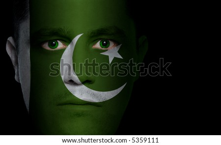 Pakistani flag painted/projected onto a man's face.