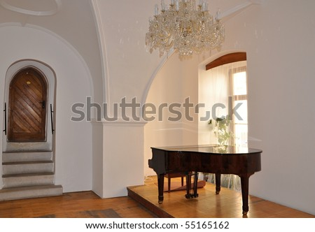 Palace hall with piano - stock photo