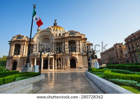 Palace of fine arts facade and Mexican flag on downtown of Mexico capital city - stock photo