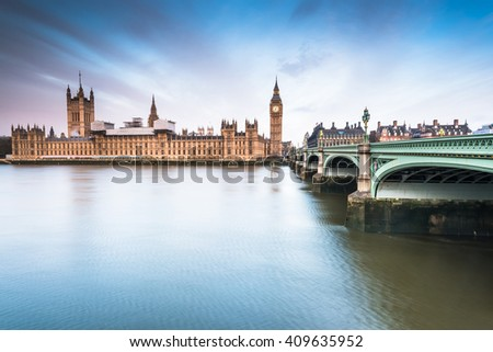 Palace of Westminster at sunrise, reflection in river Thames - stock photo