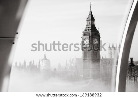 Palace of Westminster in fog seen from London Eye   - stock photo