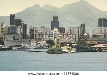 Palace on Ilha Fiscal in the harbour of Rio de Janeiro and downtown skyline at the background, Rio de Janeiro, Brazil - stock photo