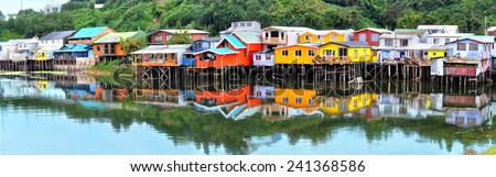 Palafitos in front of the seashore, the traditional houses of wood from the Chiloe Island - stock photo