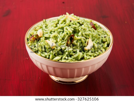 palak rice / spinach rice in a white ceramic bowl