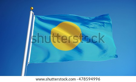 Palau flag waving against clean blue sky, close up, isolated with clipping path mask alpha channel transparency