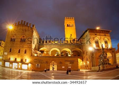 Palazzo del Podesta, Piazza Maggiore & Neptune fountain at night in the centre of Bologna. - stock photo