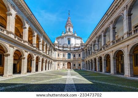 Palazzo della Sapienza with Church of Saint Yves at La Sapienza in Rome, Italy. Built in 1642-1660 by the famous architect Francesco Borromini. - stock photo