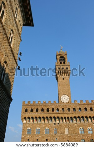 Palazzo Vecchio in Florence, lit by the late afternoon sun - stock photo