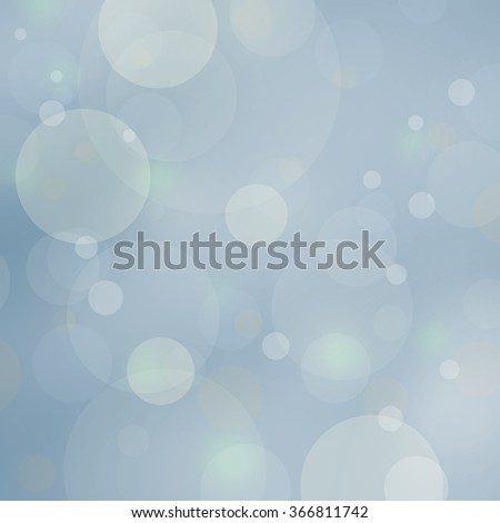 pale blue boken background lights, blurred out of focus falling snow or rain in sky, shiny glittery lights or circle shapes, floating bubble background