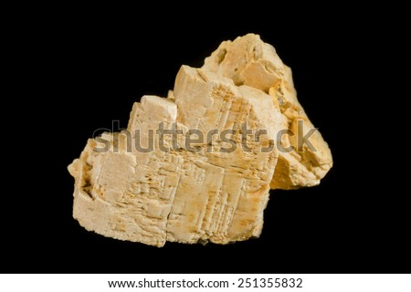 Pale colored crystal of K-feldspar from pegmatite - stock photo