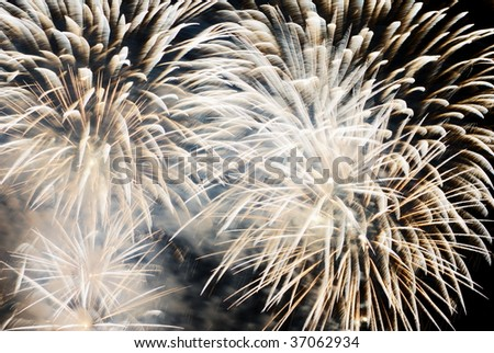 Pale golden colored fireworks explosion