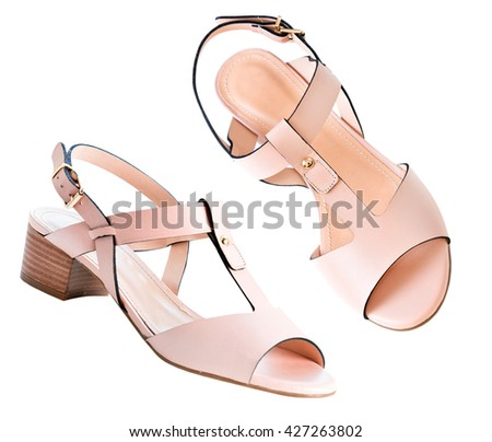 Pale pink powder color beige leather female shoes isolated on white. Summer elegant women's sandals. - stock photo