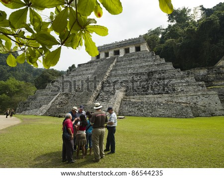 "PALENQUE, MEXICO - MARCH 18: Group of tourists visit the ""temple of inscriptions"" in Palenque, Chiapas on March 18, 2010. Palenque is a  Mayan city  in the jungles of Chiapas. - stock photo"