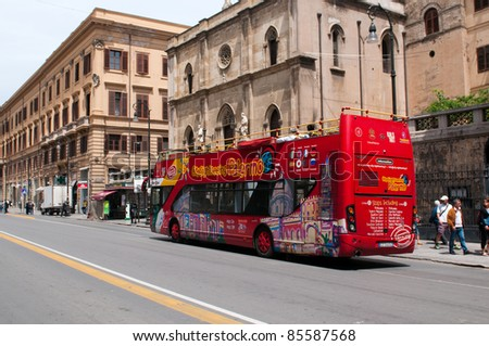 PALERMO, ITALY - MAY 2: Tourist bus on street of Palermo on May 2, 2011. Crowds of tourists visit Palermo - a historic city in Southern Italy, the capital of Sicily and the Province of Palermo.