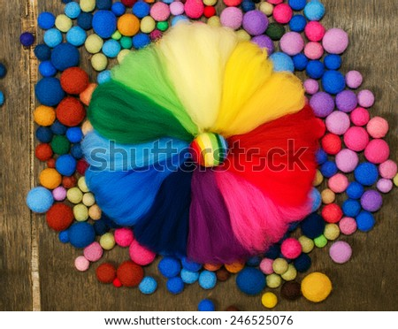 palette color circle of merino wool and  felted colored beads   - stock photo