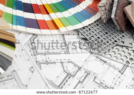 palette of colors designs for interior works, samples of plastics, PVC, for furnishing, artificial stone, perforated metal, coated with a polymer and architectural plans for houses