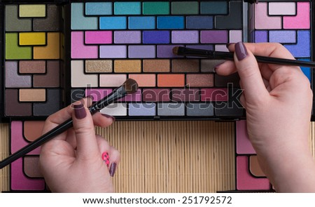 Palette of professional colorful eye shadows. Cosmetology product. - stock photo
