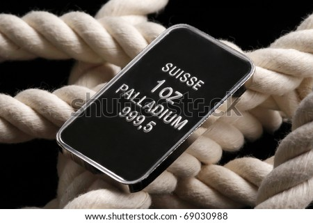 Palladium ingot on white rope - stock photo