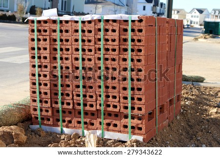 Pallet of bricks for new home construction at the job site  - stock photo