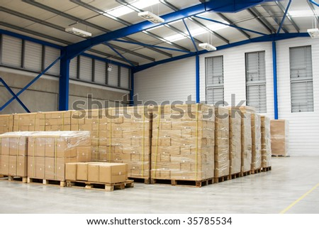 Pallets With Cartons In Warehouse - stock photo