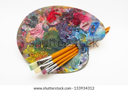 pallette with brushes on a white background - stock photo