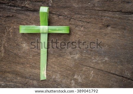 Palm Branch was folded into a Cross shape on wood. Easter Palm Sunday Good Friday Jerusalem Jesus Christ Religious God Hosanna Faith Trust Repentance Festival Maundy Thursday good Friday concept - stock photo