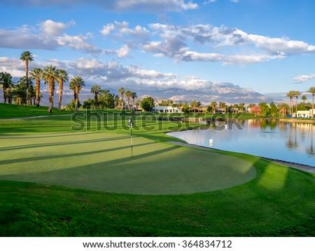 PALM DESERT, CA - NOV 15: Putting green at a golf course at the JW Marriott Desert Springs Resort & Spa on November 15, 2015 in Palm Desert, CA. The Marriott is popular golf destination. - stock photo