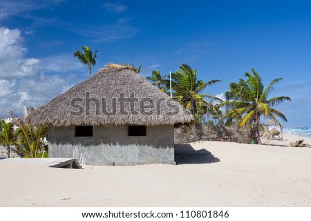 Palm leaf roof bungalow on the tropical beach, Punta Cana, Dominican Republic - stock photo