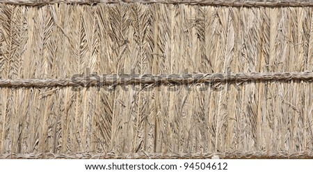 Palm leaves and branches thatched block - stock photo