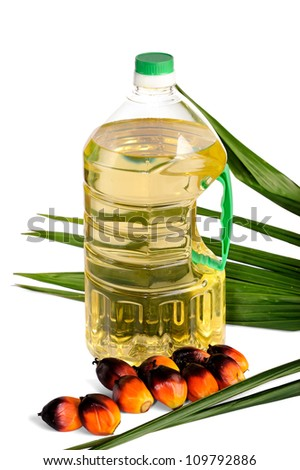 Palm Oil fruits with cooking oil isolated on white background, selective focus. - stock photo