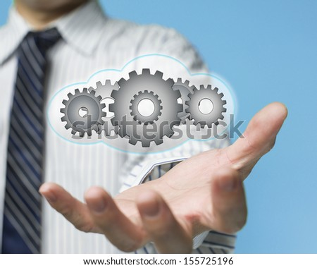 palm opening businessman with cloud fill with gears cloud computing service concept - stock photo