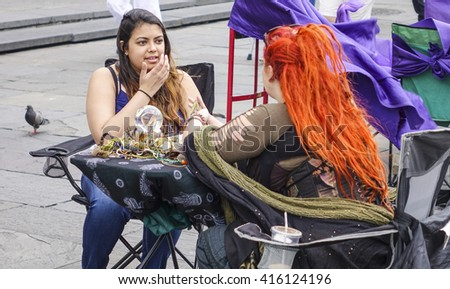 Palm Reading in New Orleans French Quarter - NEW ORLEANS, LOUISIANA - APRIL 18, 2016  - stock photo