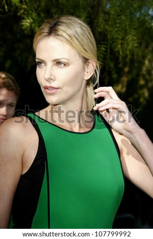 PALM SPRINGS, CA - JAN 8: Charlize Theron at the Variety's Indie Impact Award & 10 Directors to Watch brunch at the 23rd Palm Springs International Film Festival on January 8, 2012 in Palm Springs, CA - stock photo