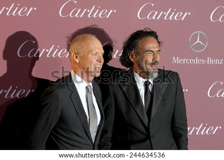 PALM SPRINGS, CA - JAN 3:Michael Keaton and Alejandro Gonzalez Inarritu arrive at the 2015 Palm Springs Film Festival Gala at the Palm Springs Convention Center on January 3, 2015 in Palm Springs, CA. - stock photo