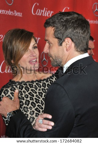 PALM SPRINGS, CA - JANUARY 4, 2014: Julia Roberts & Bradley Cooper at the 2014 Palm Springs International Film Festival Awards gala at the Palm Springs Convention Centre.  - stock photo