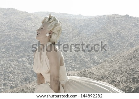 """PALM SPRINGS, CA - JUNE 2013 - Large statue of Marilyn Monroe entitled """"Forever Marilyn"""" is enjoying it's temporary stay June 2013, Palm Springs, CA. - stock photo"""