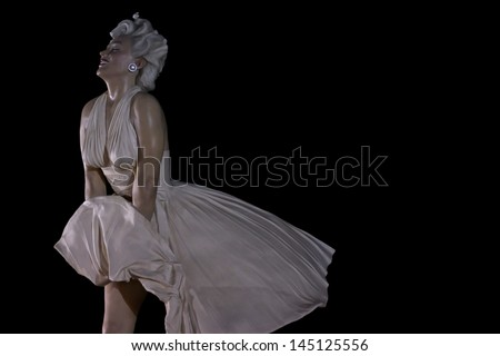 PALM SPRINGS, CA - JUNE 18: This large statue of iconic Marilyn Monroe is enjoying a temporary stay on June 18, 2013 in Palm Springs, CA. - stock photo