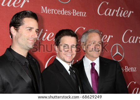PALM SPRINGS - JAN 8: Mark Wahlberg (center) arrives at the Palm Springs International FIlm Festival 2011 Awards Gala at Palm Springs Convention Center on January 8, 2011 in Palm Springs, CA. - stock photo