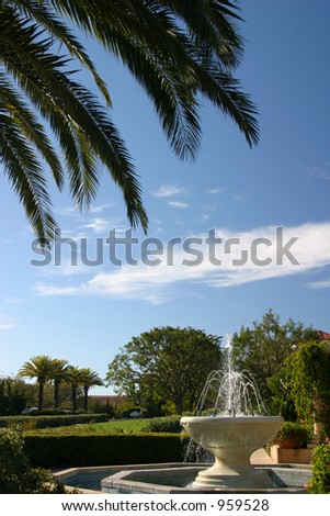 Palm tree and Spanish fountain in Southern California.