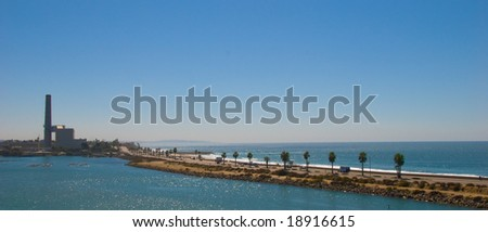 Palm Tree Lined Coastal Highway on a Clear, Blue Sky Day - stock photo