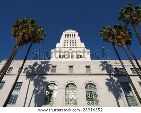 Palm trees frame the historic Los Angeles City Hall. - stock photo