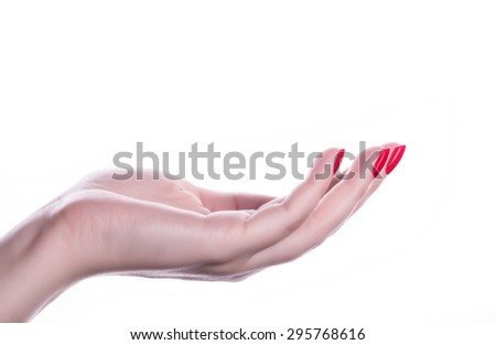 palm up beautiful woman hand with French manicure nails - stock photo