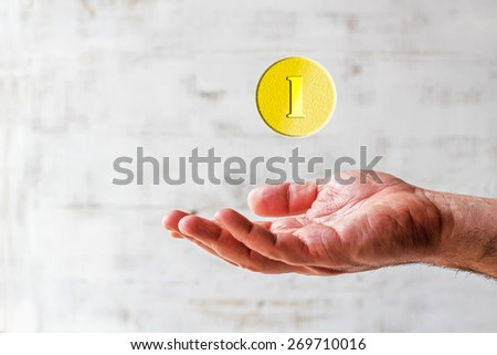 Palm up with coin background - stock photo