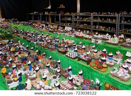 PALMA DE MALLORCA, BALEARIC ISLANDS, SPAIN - DECEMBER 3, 2016: Miniature figurines in vendor booth in the Plaza Mayor Christmas market  on December 3, 2016 in Palma de Mallorca, Spain.