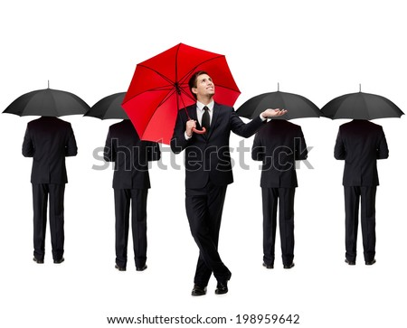 Palming up man with opened red umbrella checks the rain, isolated on white. People with umbrellas stand behind him - stock photo